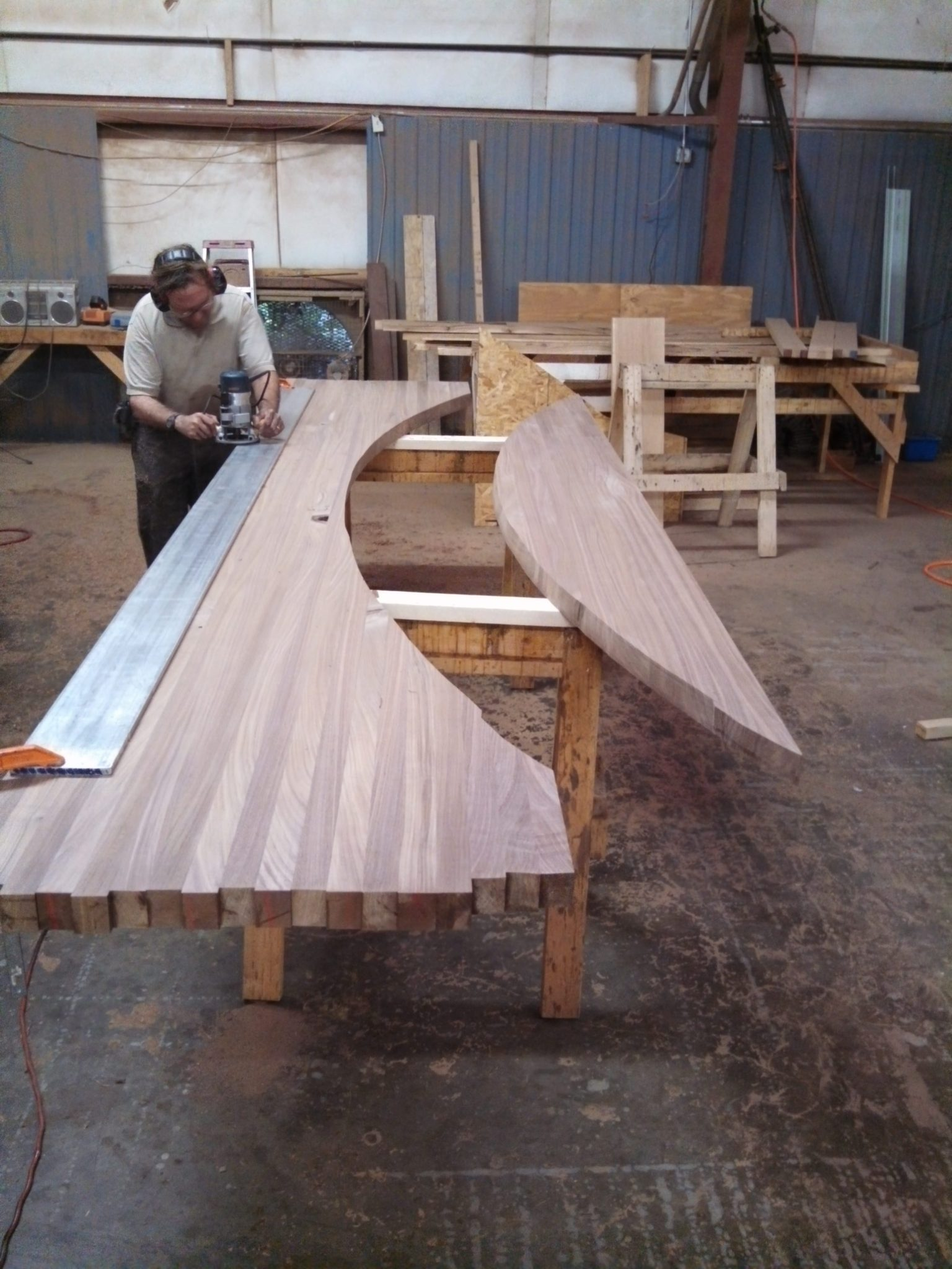 Wood bar top being cut to size