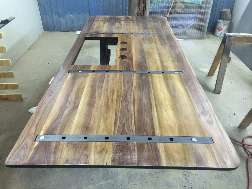 Wood countertop with hidden steel support bars.