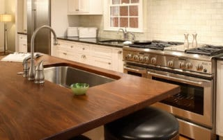 wood island top with sink and stools