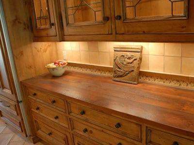 Wood countertop in built in buffet.