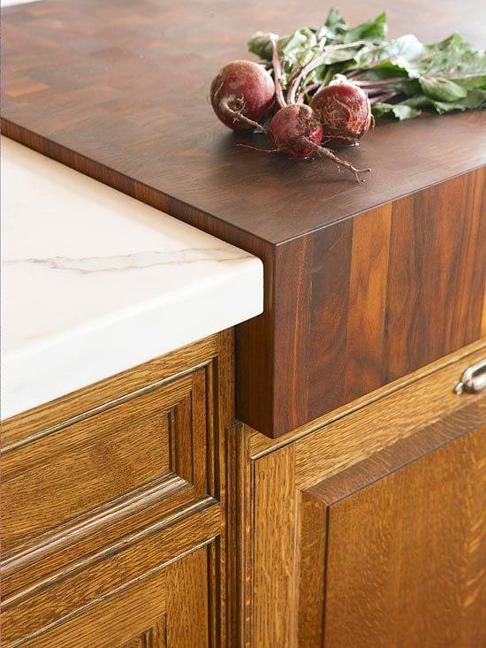 Wood countertop in a granite counter.