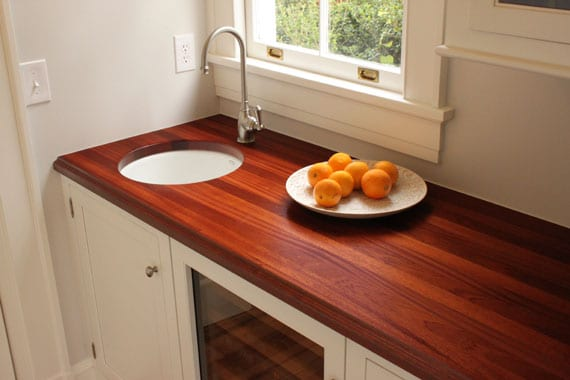 Wood countertop with small sink.