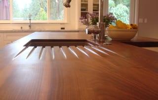 Drain channels in a wood countertop