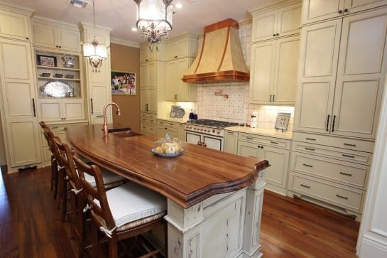 Wood kitchen island top with a sink.