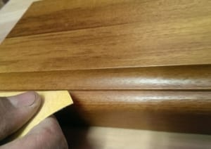 Sanding a wood profile.