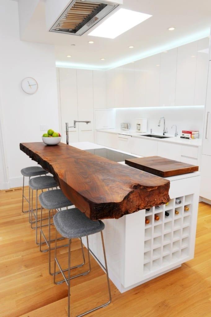 Medium-luxury-kitchen-with-white-kitchen-island-wooden-side-board-teak-wood-glass-roof.jpeg