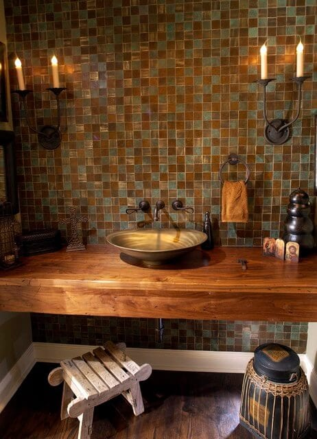 Wood vanity and vessel sink.