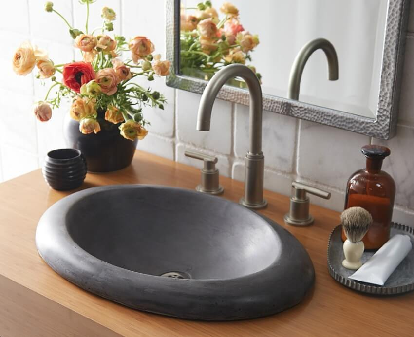Stone drop in sink with wood vanity top