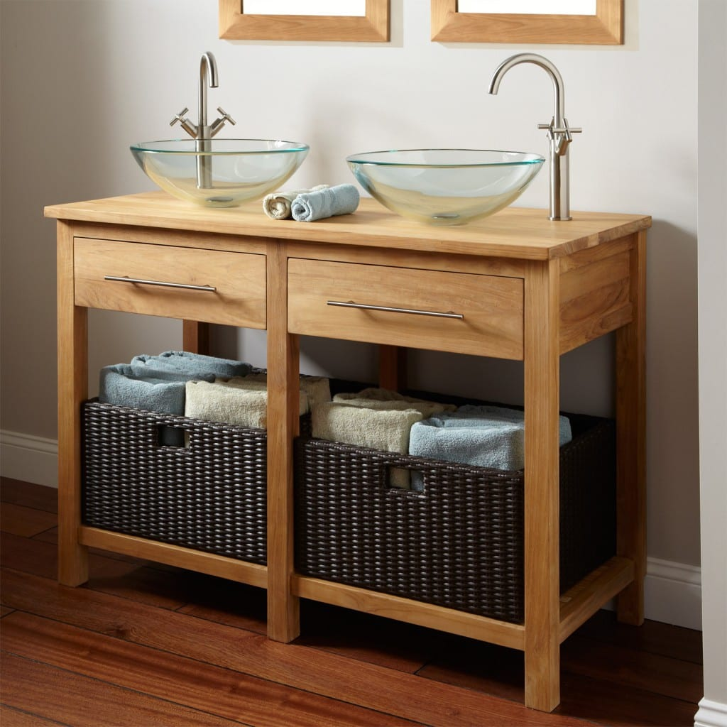 Two glass sinks on wood vanity