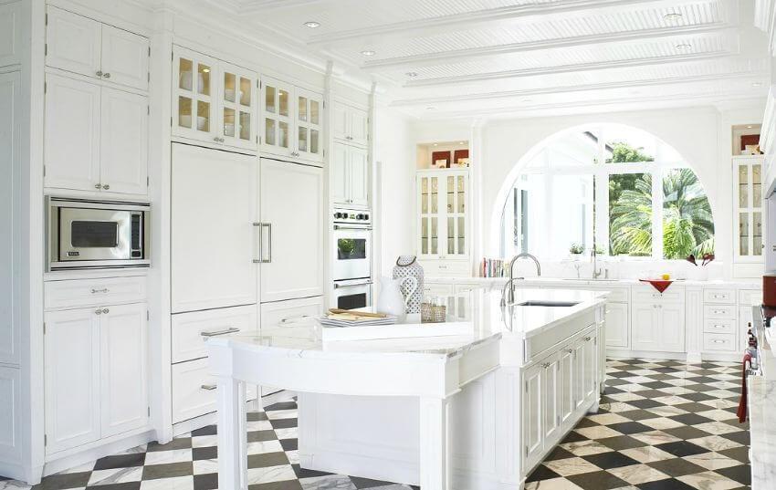 White kitchen with checkerboard floor.