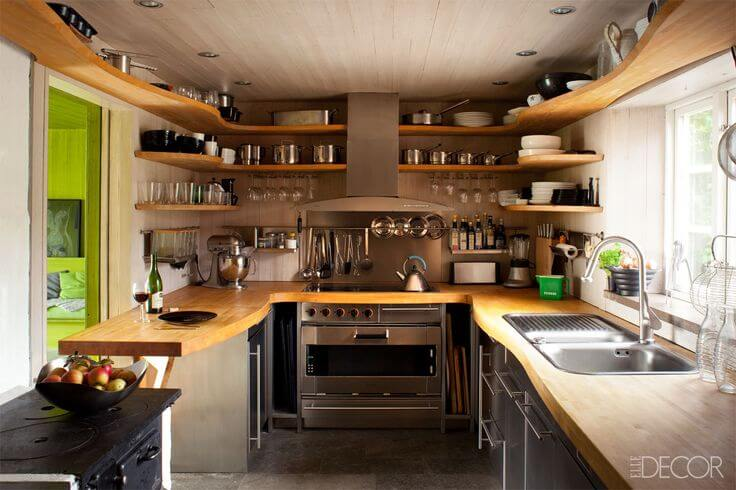 Wood counters and shelving in small kitchen.