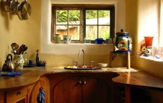 Wood countertops in adobe house