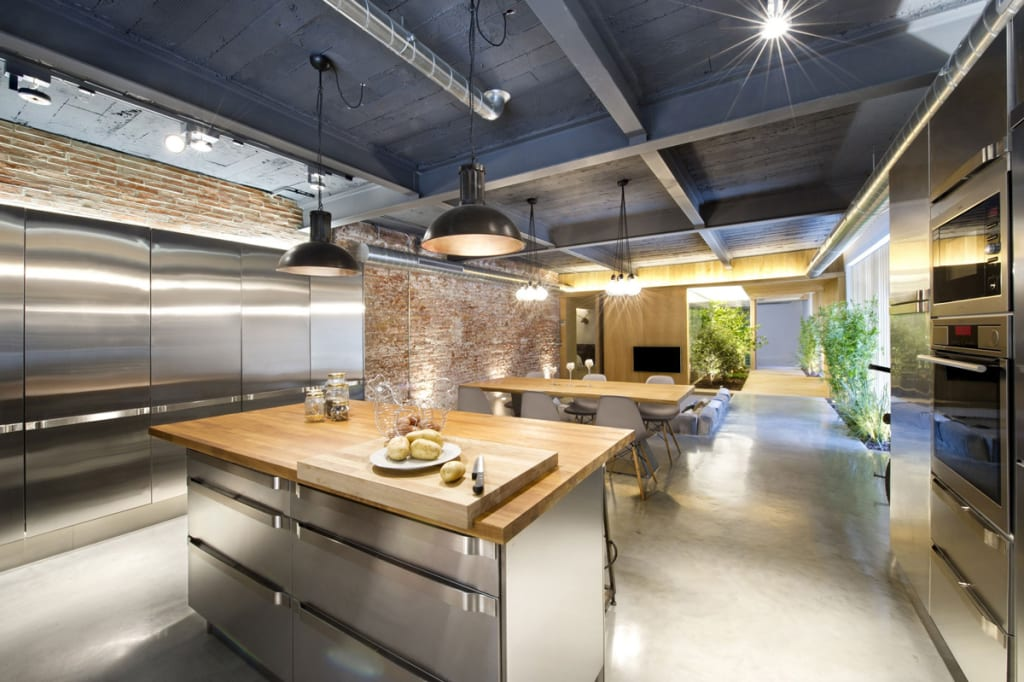 Stainless steel and industrial lighting give this space a laboratory feel thatu0027s softened by the use of warm wood countertops and mellow brick. & Using Wooden Countertops in Loft Kitchens - J. Aaron azcodes.com