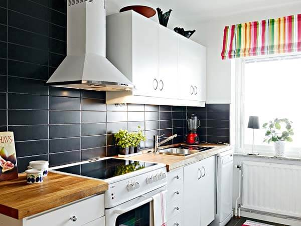 Small kitchen with wood countertops.