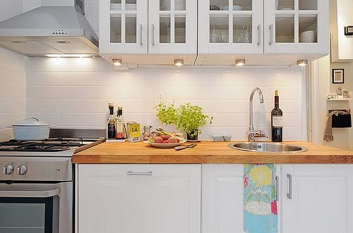 Small kitchen with wood countertop.