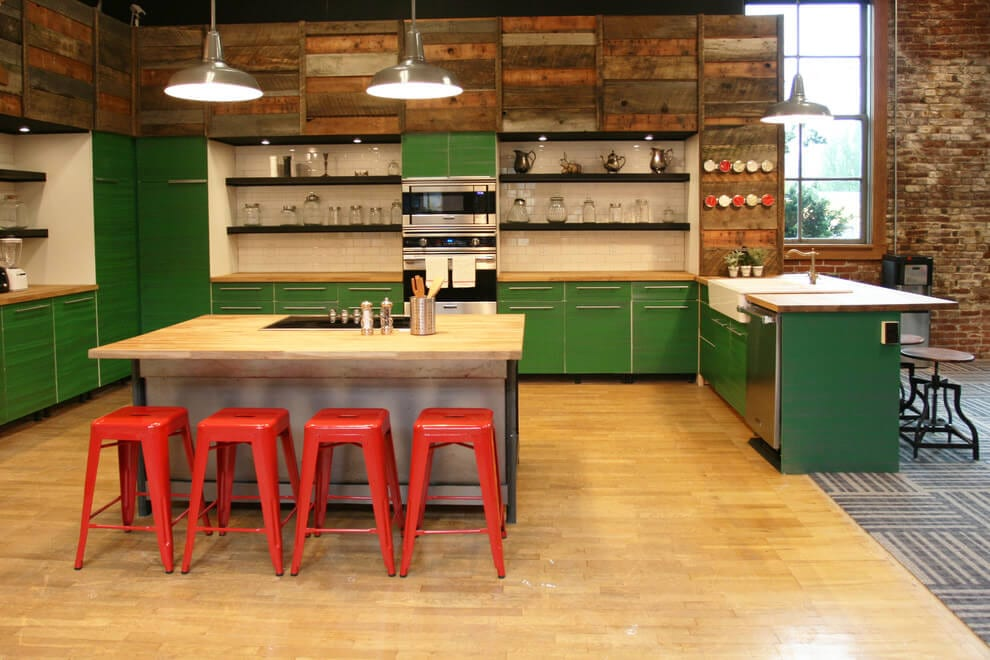 This Playful Design Uses Strong Pops Of Color And Warm Golden Wood  Countertops And Floor To Brighten A Loft Kitchen. The Industrial Lighting  Is A Nod To The ...